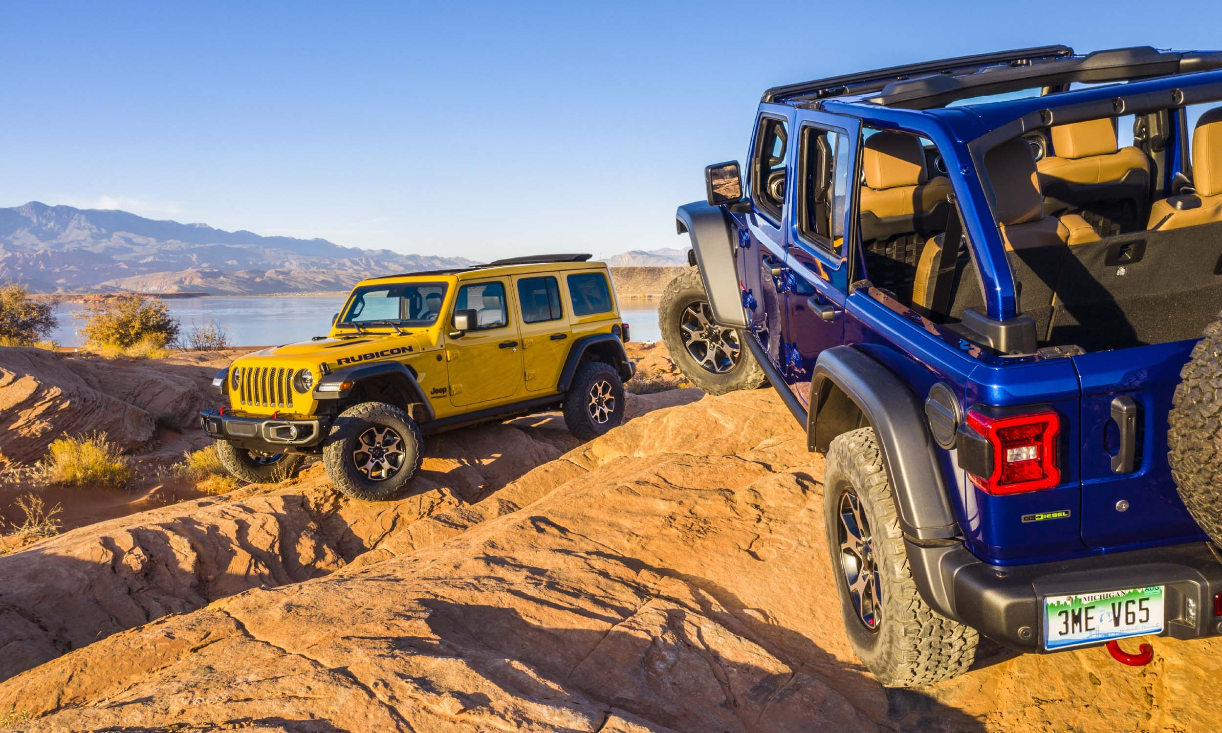 2021 Jeep Wrangler Jeep offers the 2021 Wrangler in five trim levels: Sport, Sport S, Sahara, Rubicon and High Altitude, with Sahara and High Altitude offered exclusively as a 4-door Unlimited and the other three available in both 2-door and 4-door Unlimited versions. For 2021 Jeep will also add the plug-in hybrid Wrangler 4xe, high-performance Wrangler Rubicon 392 and two new limited editions: Islander and 80th Anniversary. For 2021 Jeep also offers Willys, Freedom, Sport Altitude and Sahara Altitude limited edition. Available powertrains included the 285-horsepower Pentastar V6, a new turbocharged 4-cylinder engine with eTorque technology producing 270 horsepower and 290 lb-ft of torque, a 3.6-liter V6 with mild-hybrid eTorque assist, and a 3.0-liter V6 EcoDiesel producing 260 horsepower and 442 lb-ft of torque. For 2021 Wrangler offers the TrailCam forward-facing off-road camera with an 8.4-inch touchscreen that can be accessed through available Off-road Pages. 2021 Jeep Wrangler 4xe In September 2020 Jeep announced a new plug-in hybrid Wrangler 4xe with electric-only mode — including while off-road — with the same off-pavement capabilities as its non-electric siblings. Wrangler 4xe is powered by a 2.0-liter turbocharged 4-cylinder gas engine and two electric motors for a total output of 375 horsepower and 470 lb-ft of torque. Wrangler 4xe EPA fuel-economy ratings have not been released, although Jeep estimates 50 MPGe in electric mode and an electric-only range of about 25 miles. All high-voltage electronics that connect the battery to the powertrain are sealed and waterproof, ensuring that Wrangler can still navigate up to 30 inches of water without any danger of short circuiting. 2021 Jeep Wrangler Rubicon 392 In November 2020 Jeep announced the 2021 Wrangler Rubicon 392, the first Wrangler powered by a V8 engine since 1981. In the '80s Wrangler's 5.0-liter V8 produced a mere 125 horsepower. Fast-forward 40 years and Wrangler Rubicon 392 gets a 6.4-liter 392-cubic-inch V8 producing 470 horsepower and 470 lb-ft of torque, paired with an 8-speed automatic transmission. According to Jeep, Rubicon 392 will accelerate from zero to 60 mph in 4.5 seconds and complete the quarter mile in 13 seconds. Rubicon 392 is lifted one inch higher than the standard Rubicon and features 17-inch bronze wheels with a beadlock option and 33-inch off-road tires. Jeep's Selec-Trac four-wheel-drive system is standard and heavy-duty front and rear Dana 44 axles with electronic locking differentials add to the impressive capability. 2021 Jeep Wrangler 80th Anniversary To commemorate the 80th anniversary of Jeep, a Wrangler 80th Anniversary has Granite exterior accents including the grille surround, fog light bezels and badges; 18-inch Granite Crystal aluminum wheels; all-terrain tires; body-color fender flares; and a three-piece black hardtop. Inside, Wrangler Anniversary features Granite Crystal accents, Uconnect 4C NAV with an 8.4-inch touchscreen, an Alpine premium audio system and optional leather seats. Jeep also adds Wrangler Islander, a beach-themed limited edition with exterior and interior details that include a Tiki decal on the hood, 17-inch wheels with silver finish, 32-inch all-terrain tires, rock rails, embroidered Tiki logo on front seat and Surf Blue accent stitching.